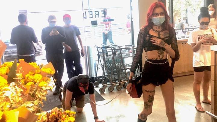 Photo Of Dominatrix Walking Man Through Supermarket On Lead Goes Viral