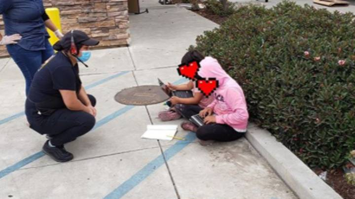 Viral Photo Shows Two Little Girls Using Taco Bell WiFi To Do School Work