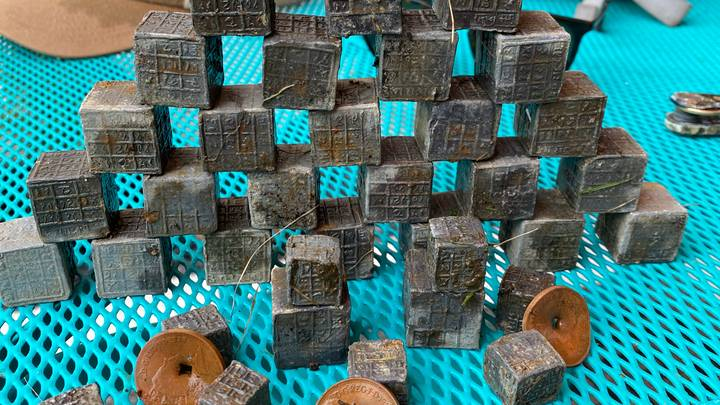 Magnet Fisherman Finds Haul Of Mysterious Engraved Cubes