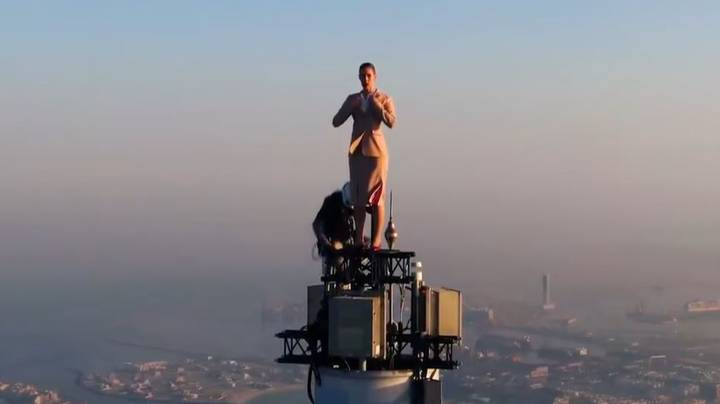 Woman Stands On Top Of Burj Khalifa For Advert