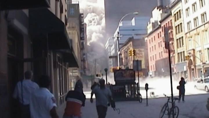 9/11 Footage Shows Moment Shop Owner Saved Woman From Wall Of Dust