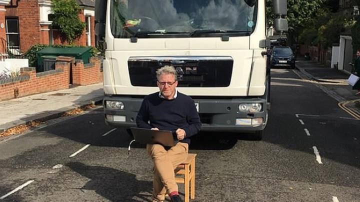 Man Sits On Chair In Road To Stop Porsche Being Towed