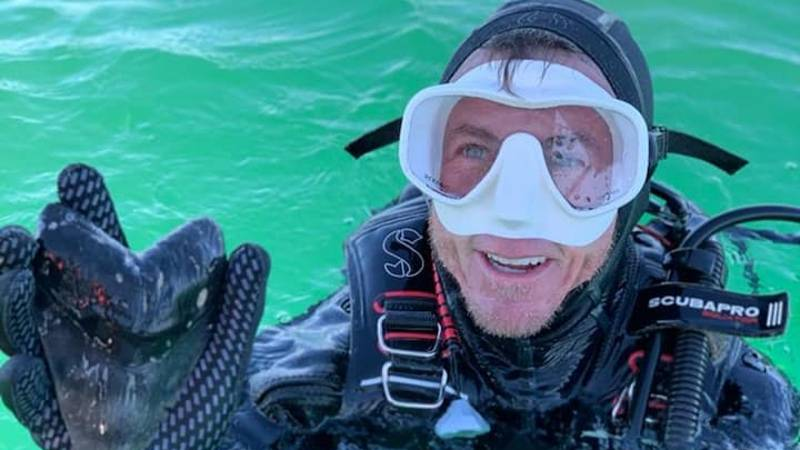Diver Finds Huge Shark Tooth While Out At Sea