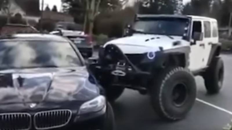 Jeep Driver Gets Parking Rage And Nudges BMW Into Place