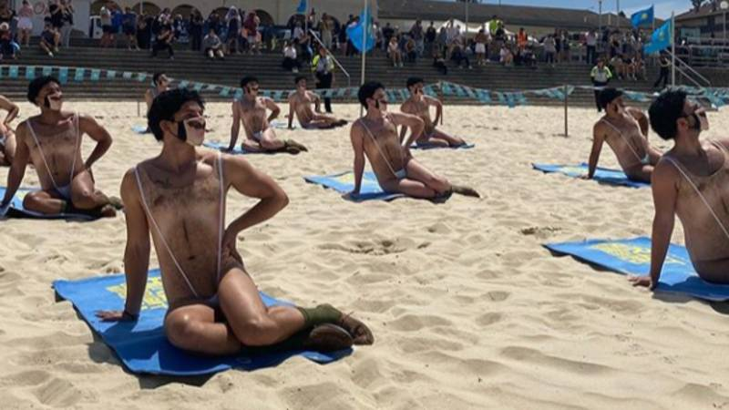 Forty Men In 'Maskinis' Crash Bondi Beach In Borat 2 Stunt