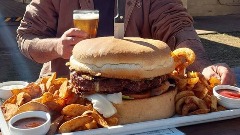 Aussie Pub Challenges People To Try And Finish Their Mammoth Burger