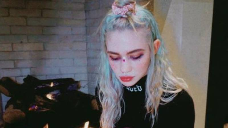 Grimes Says She's 'Weirdly Enjoying' It After Catching Covid