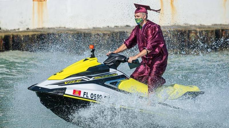 Graduating Students In US Ride Jet Skis To Collect Diplomas From Boat