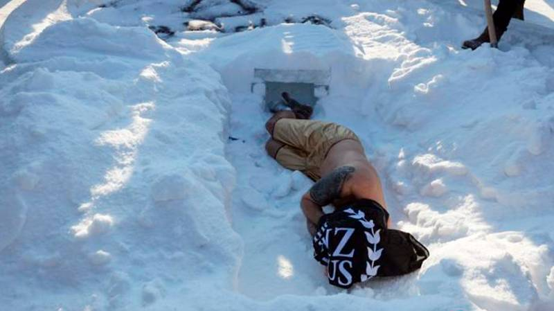 Man Buried Alive In Snow For 13 Minutes In Bizarre Valentine's Day Stunt