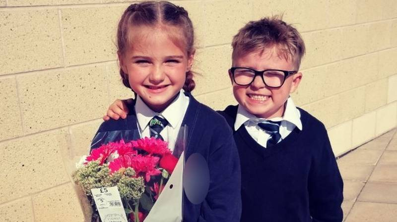 Schoolboy, 7, Waits Outside Gates With Flowers To 'Win Back' Girlfriend