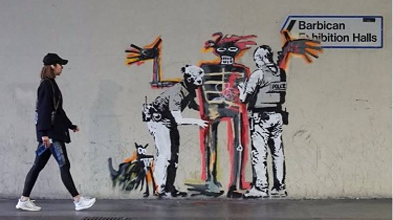Banksy Takes Aim At London's Barbican Centre With Two New Murals