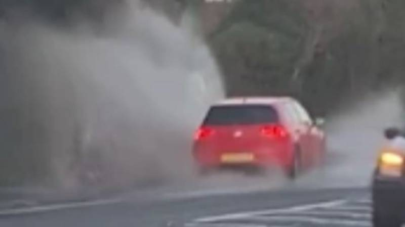 Shocking Footage Shows Moment 'Police Officer' Is Drenched By Puddle