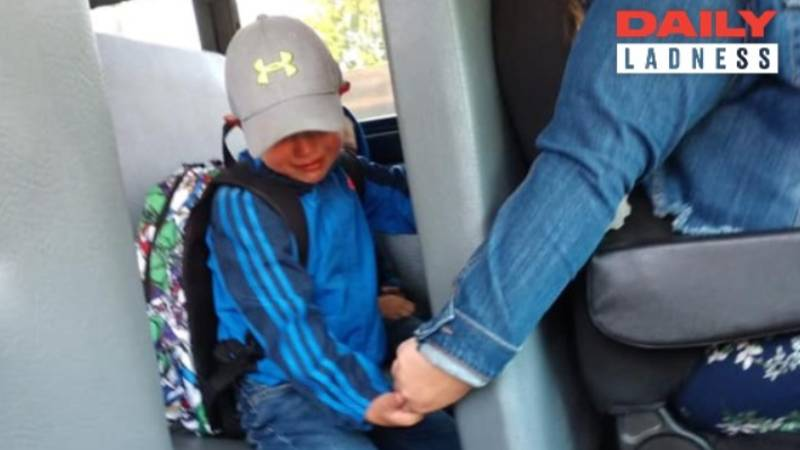 Bus Driver Holds Nervous Boy's Hand On First Day Of School