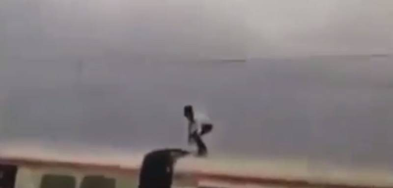 Terrifying Footage Shows Man Performing Stunts On Top Of A Train