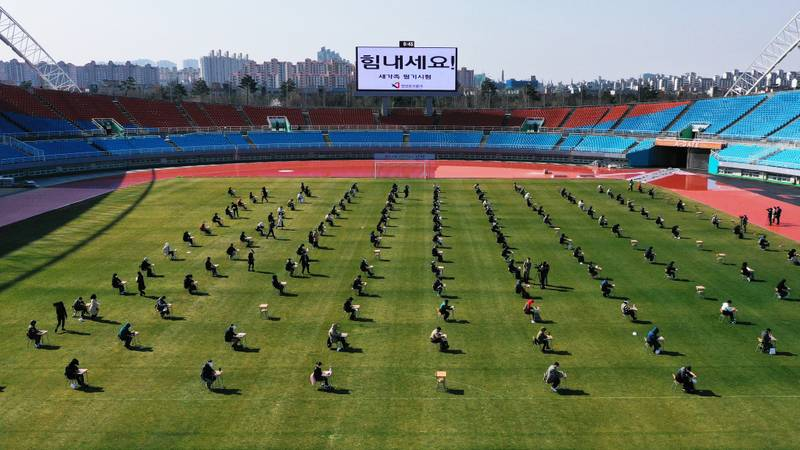 South Korean Jobseekers Take Written Exam In Football Stadium To Avoid Coronavirus