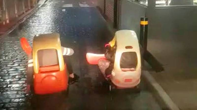 Two Kids Go Through McDonald's Drive-Thru In Little Tykes Toy Cars