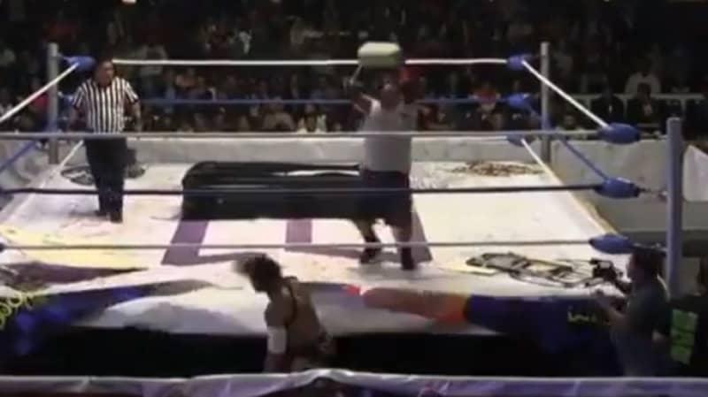 Wrestler Throws Concrete Block Onto Opponent's Head