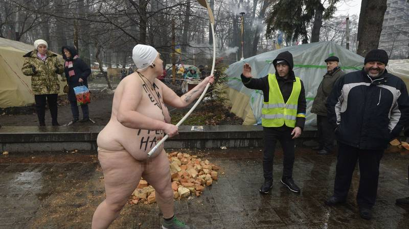 ​Naked Woman With 'Row The F*** Away' Written On Body Arrested Outside Ukrainian Parliament