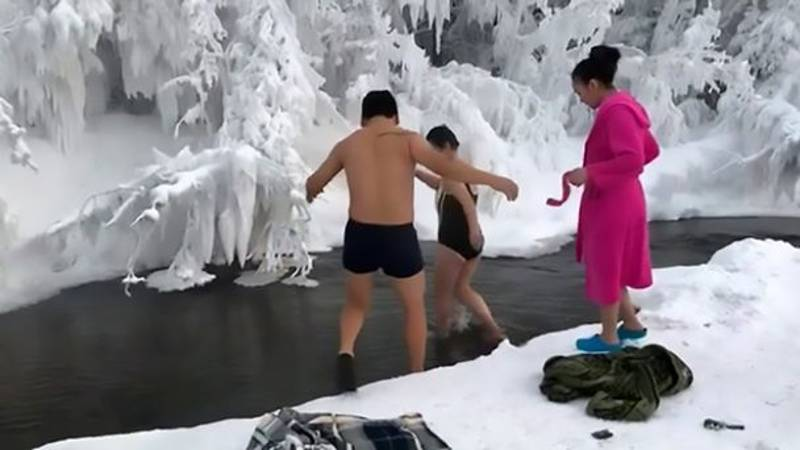 Russian Bathers Go For A Icy River Swim At -65C Temperatures