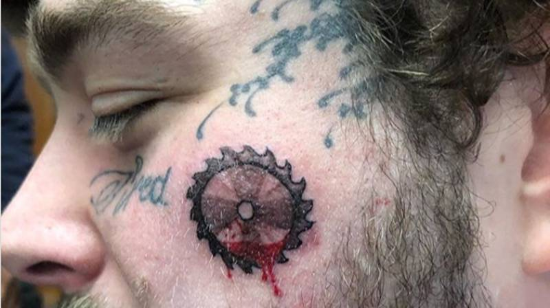Post Malone Adds Bloody Saw Blade To Collection Of Face Tattoos
