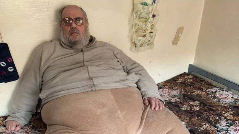 Overweight ISIS Mufti Lifted Onto Back Of A Truck As He Is Arrested In Mosul