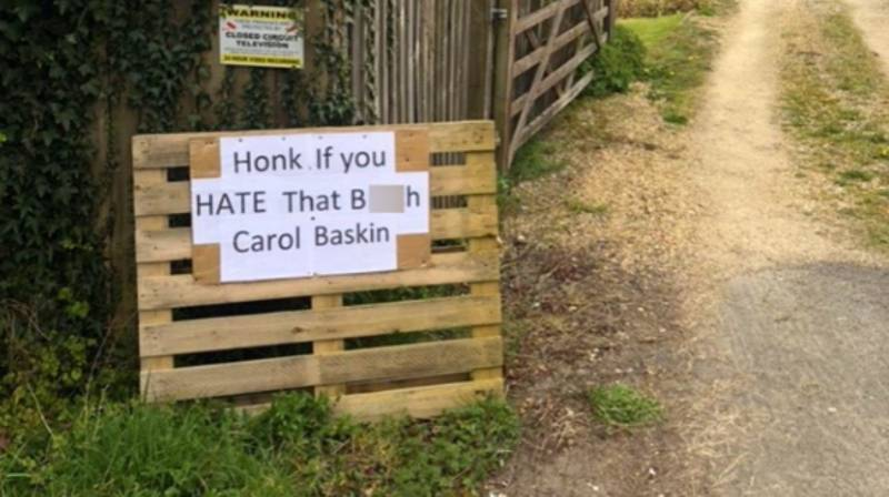 Couple Forced To Take Down 'Honk If You Hate That B***h Carole Baskin Sign'