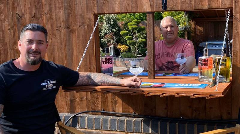 Neighbours Build Gin Hatch In Garden Fence To Drink Together During Lockdown