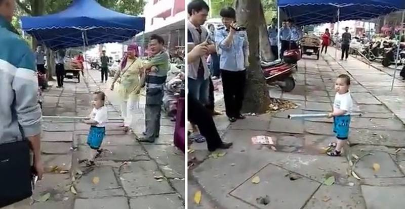 Little Lad Picks Up Steel Pipe To Defend His Grandma From Authorities