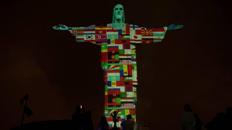 Christ The Redeemer Statue Illuminated With Flags Of Coronavirus-Hit Countries