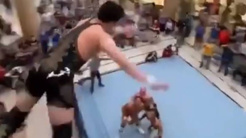 ​Wrestler Launches Himself Into Ring From Shopping Mall Balcony