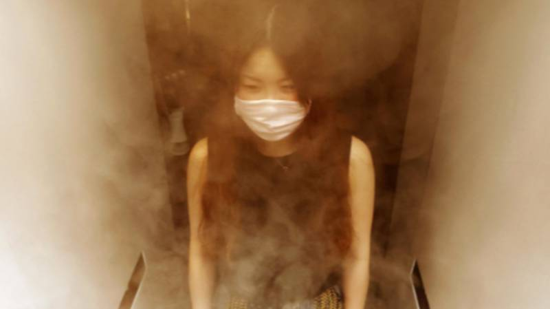Japanese Pub Sprays Customers With Disinfectant As They Enter